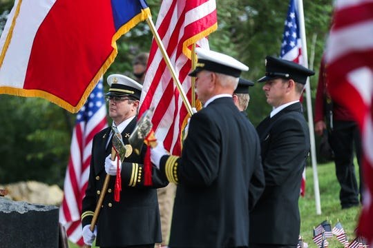 Members of the San Angelo Fire Department present the colors for a 9/11 Memorial Ceremony Tuesday, Sept. 11, 2018, at the monument near Celebration Bridge.