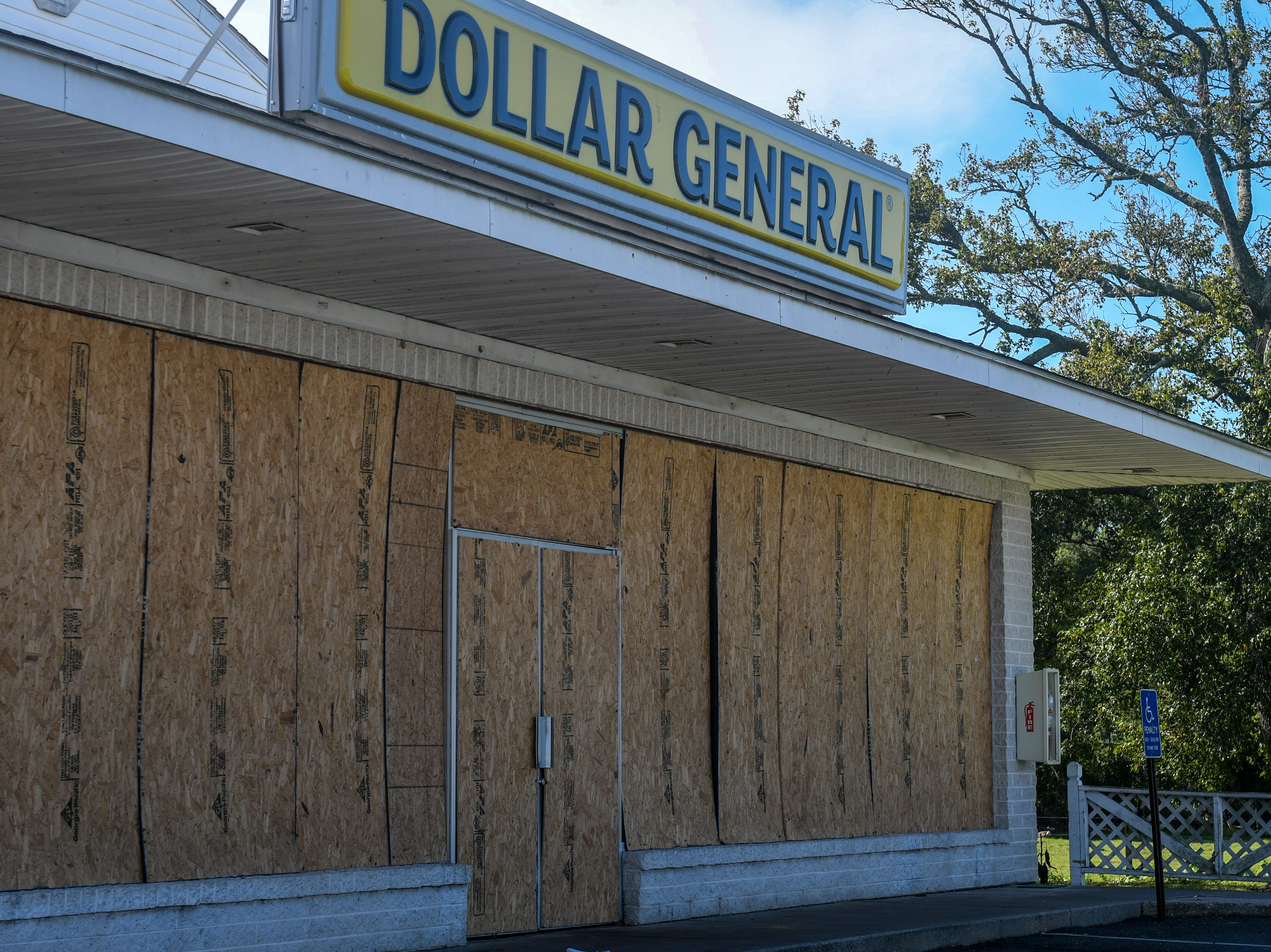 The Dollar General on Chincoteague Island is one of the few buildings that was already boarded up by Tuesday, Sept. 11. The island is part of the state's zone A evacuation that was issued in advance of Hurricane Florence, but local officials have not yet asked residents to leave.