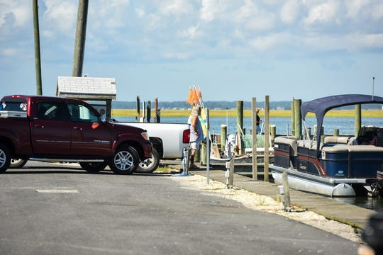 Locals took boats out of the harbor on Chincoteague Island on Tuesday, Sept. 11 to prepare for the upcoming storm. The island is part of the state's zone A evacuation that was issued in advance of Hurricane Florence, but local officials have not yet asked residents to leave.