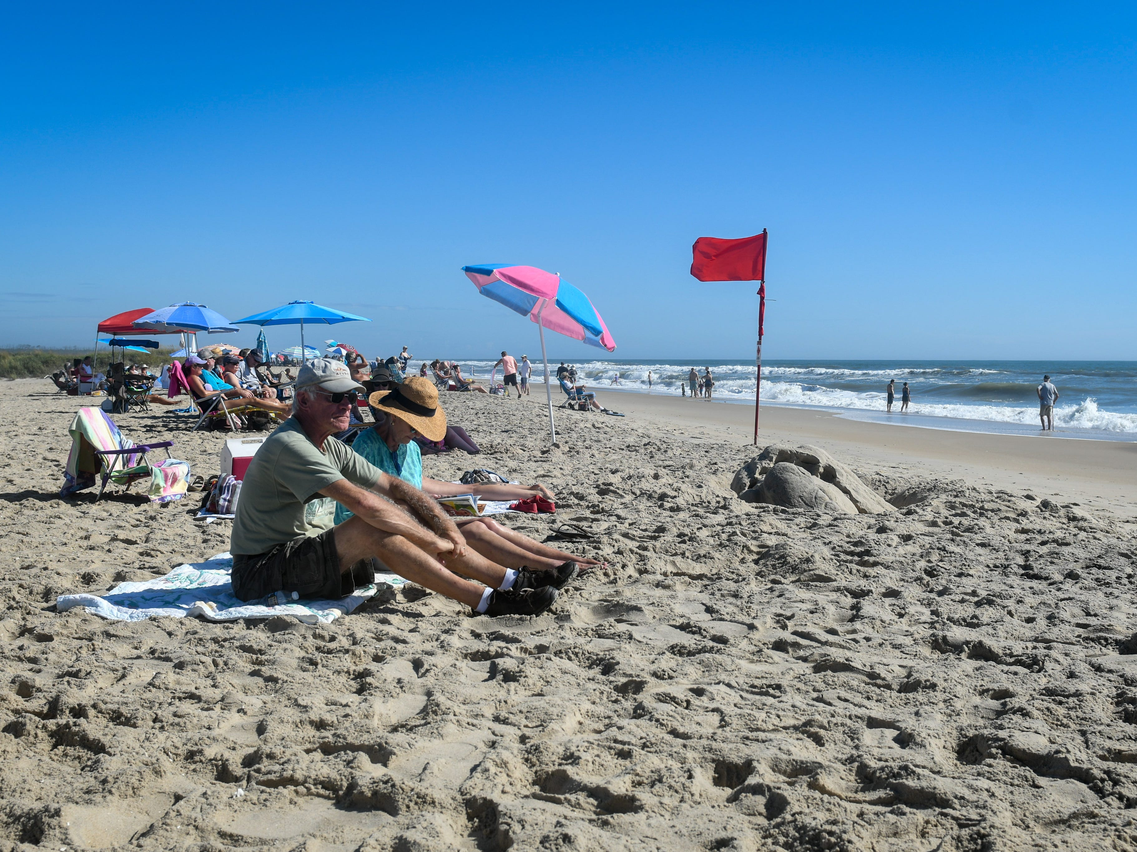 Carol and Ed Ryan, visitors from Long Island, enjoyed the beach on Tuesday, Sept. 11. The two said they had heard the island is part of the state's zone A evacuation that was issued in advance of Hurricane Florence, but are not planning on leaving yet.