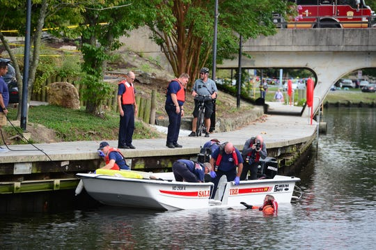 A Salisbury Fire Department diver helps remove a body that was found in the Wicomico River near South Division Street Bridge around 12:30 p.m.