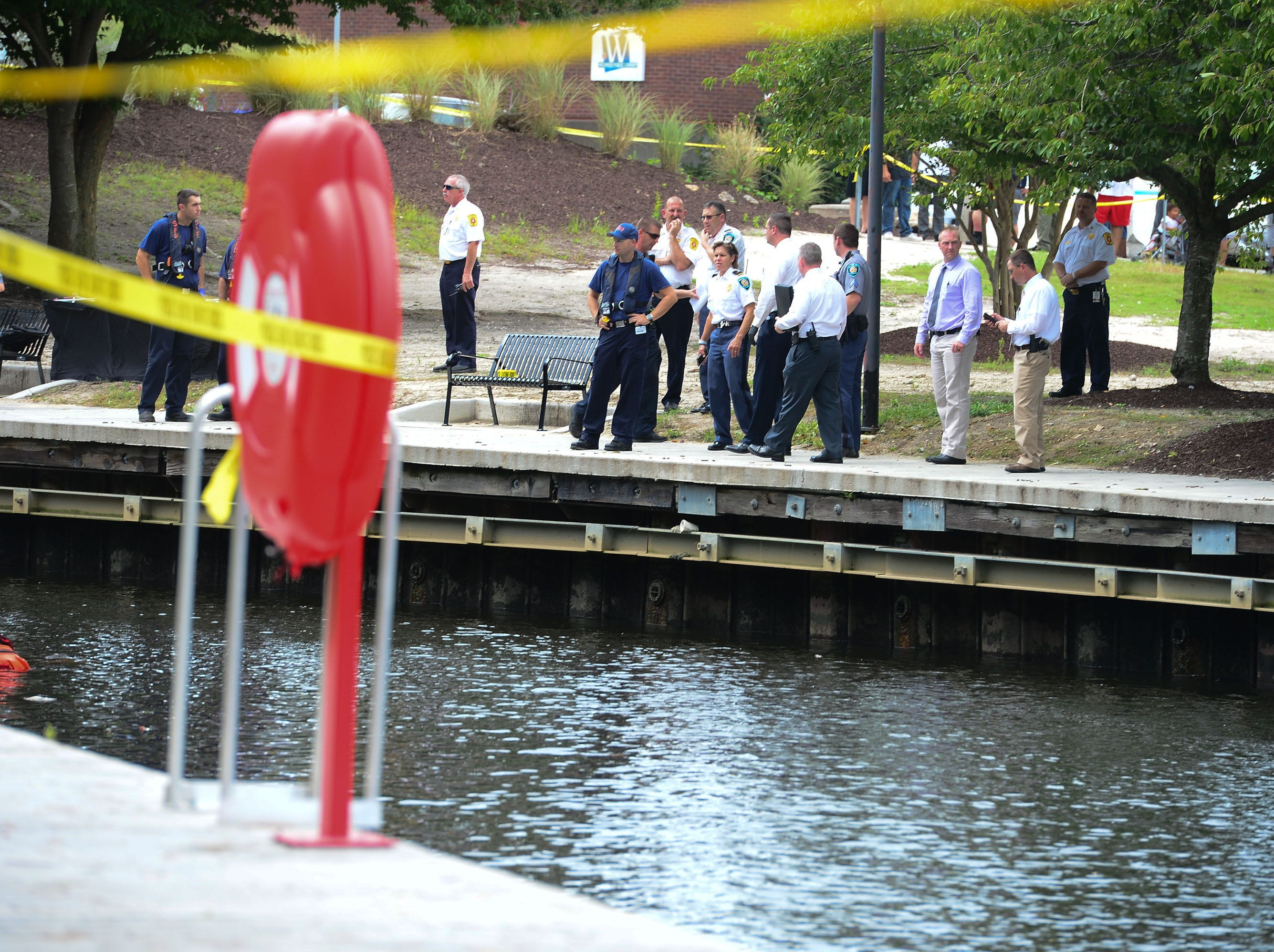 Salisbury Police line the Wicomico River near South Division Street Bridge after a body was found floating in the river around 12:30 pm