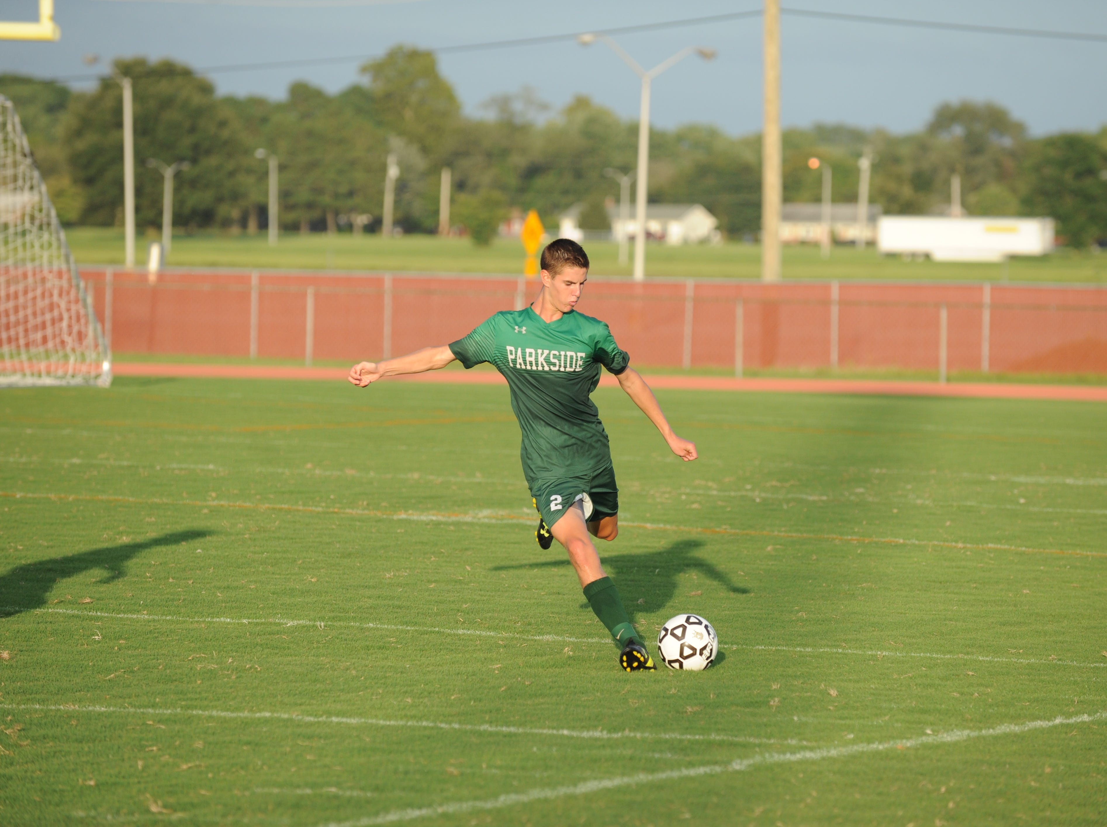 Parkside defender Stevie Mancha prepares to kick a ball up field during the Rams' boys soccer game against Bennett Monday night at County Stadium.