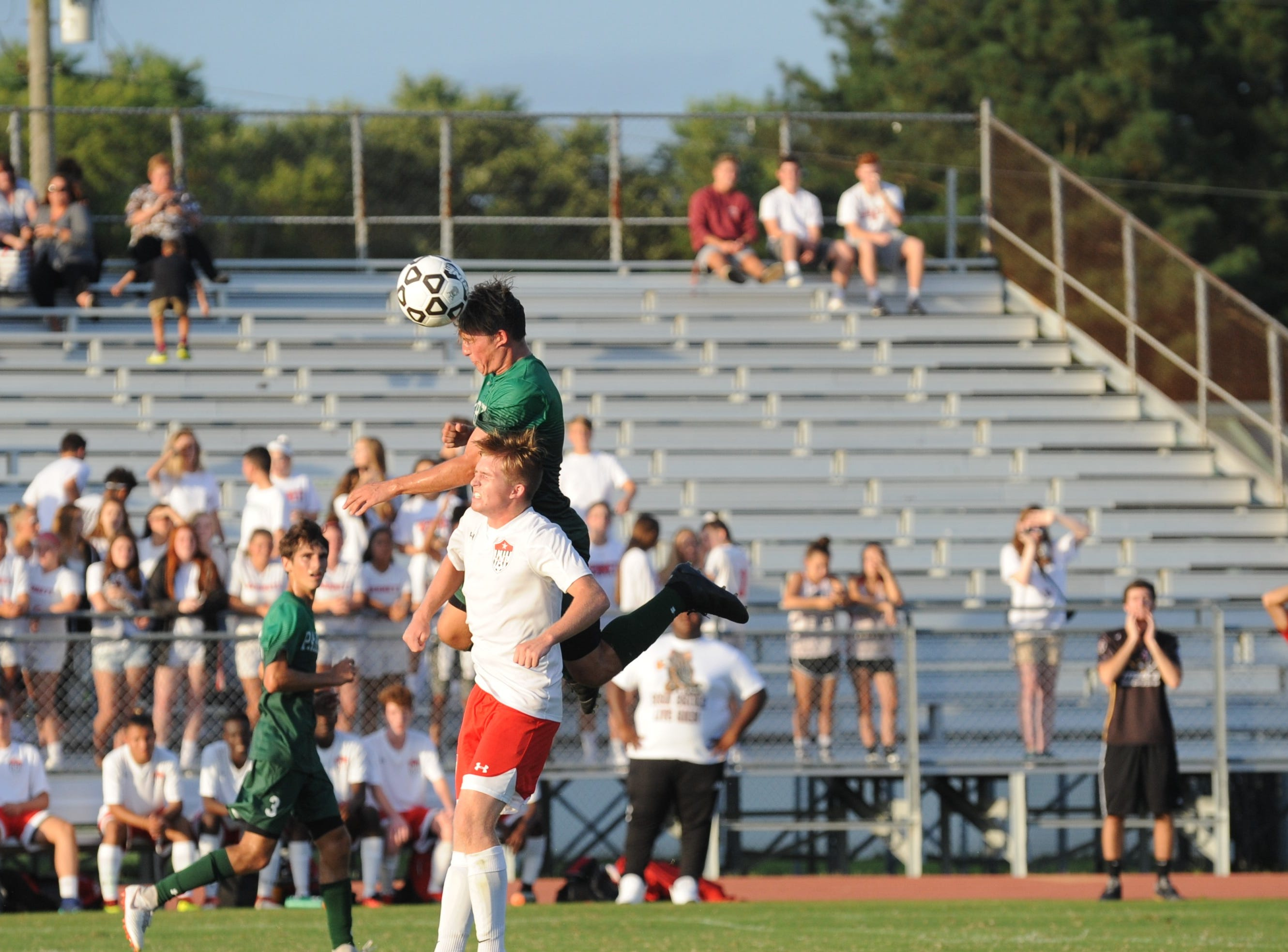 A Parkside player goes up for header during the Rams' boys soccer game against Bennett Monday night at County Stadium.