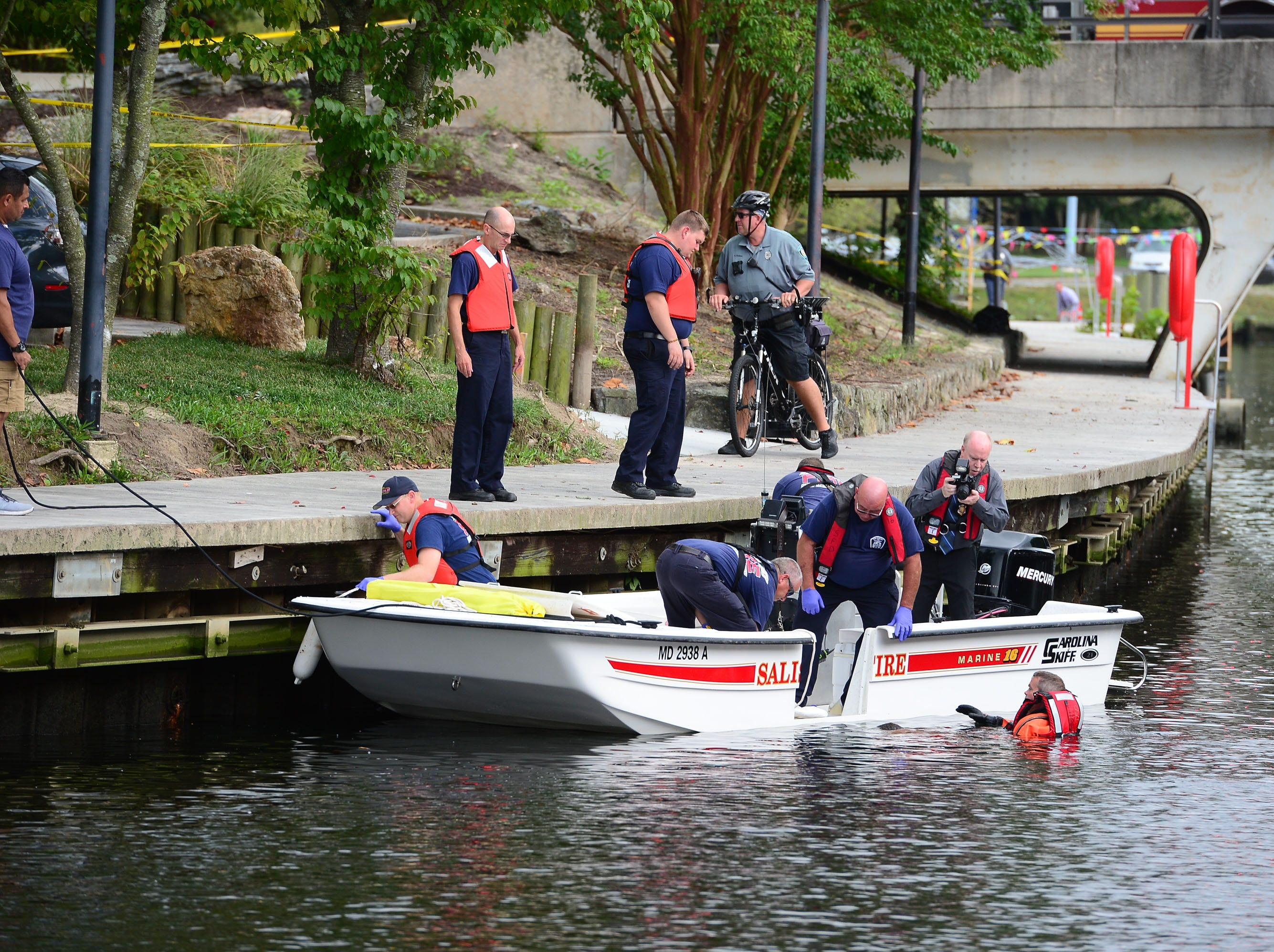A Salisbury Fire Department diver helps remove a body that was found in the Wicomico River near the South Division Street around 12:30 p.m.