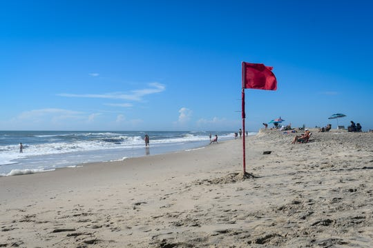 A red flag signifies rough surf conditions on Assateague Island on Tuesday, Sept. 11. The island is part of the state's zone A evacuation that was issued in advance of Hurricane Florence, but local officials have not asked residents to leave yet.