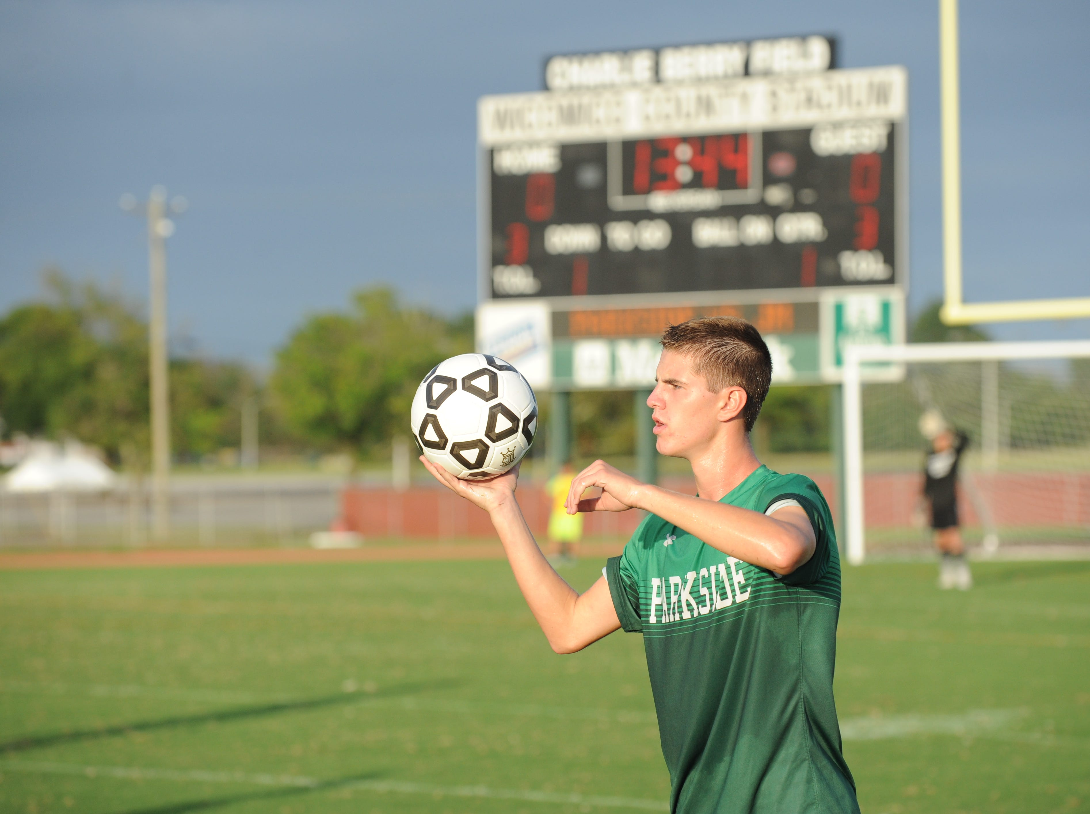 Parkside defender Stevie Mancha goes for a throw-in during the Rams' boys soccer game against Bennett Monday night at County Stadium.