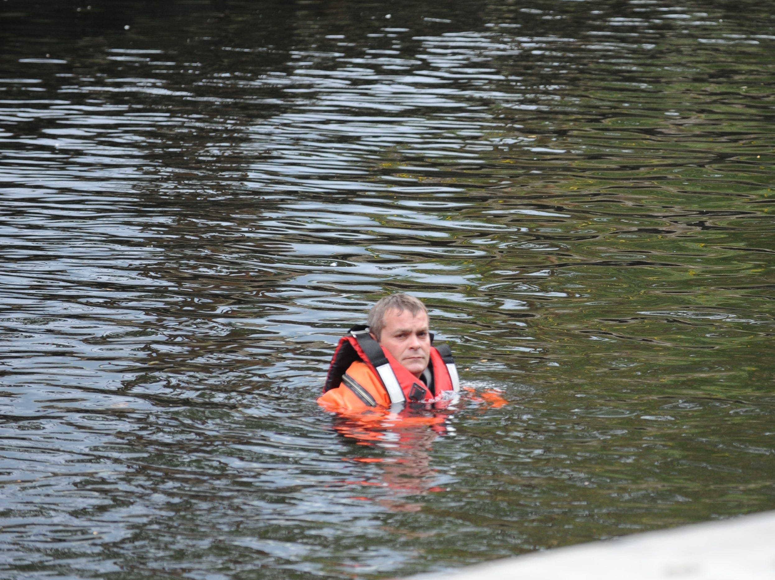 A diver investigating a body found in the Wicomico River.