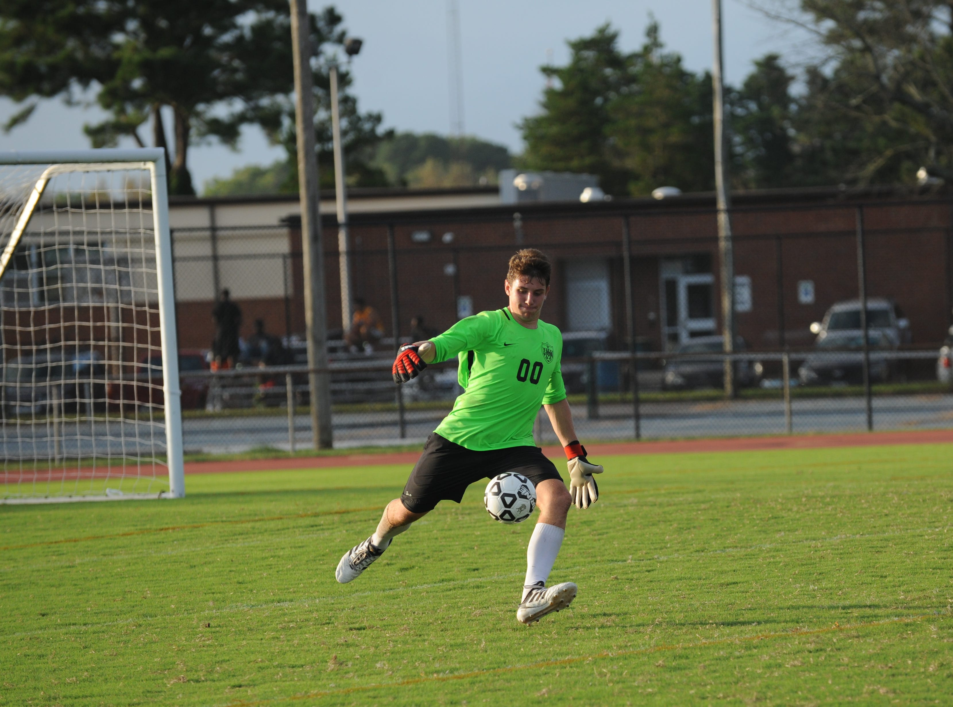 JMB keeper Gabe Dunn kicks the ball up field during Bennett's boys soccer game against Parkside Monday night at County Stadium.