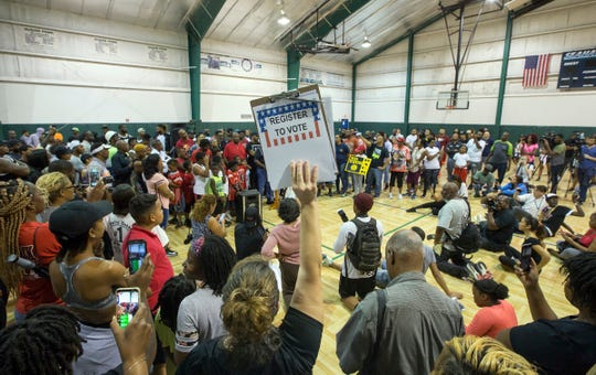 """""""Unity in Community"""" rally at Susan Park Playground which was organized as a """"peaceful protest"""" after widely-circulated memo by Kenner Mayor Ben Zahn banning Kenner's recreation booster clubs from purchasing Nike gear, Kenner, La. Monday, Sept. 10, 2018. (David Grunfeld /The Times-Picayune via AP)"""