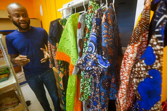 Fola Sodada, owner of Jums African Market, talks about some of the traditional African clothing that he sells at his market.