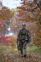 A bow hunter heading out as the archery season for deer and turkey opens.