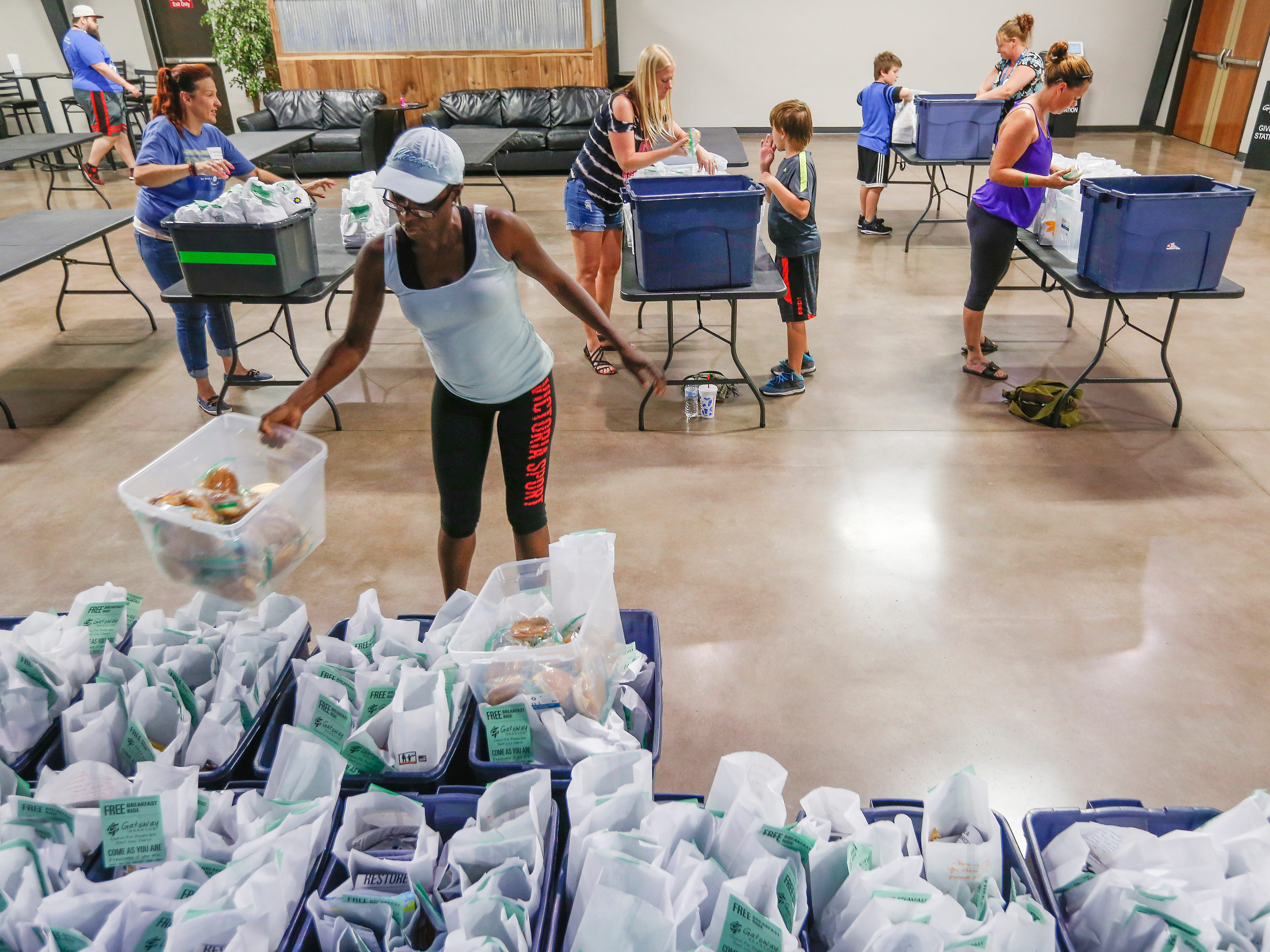 Volunteers pack meals at Jesus Was Homeless in Branson on Thursday, July 5, 2018.