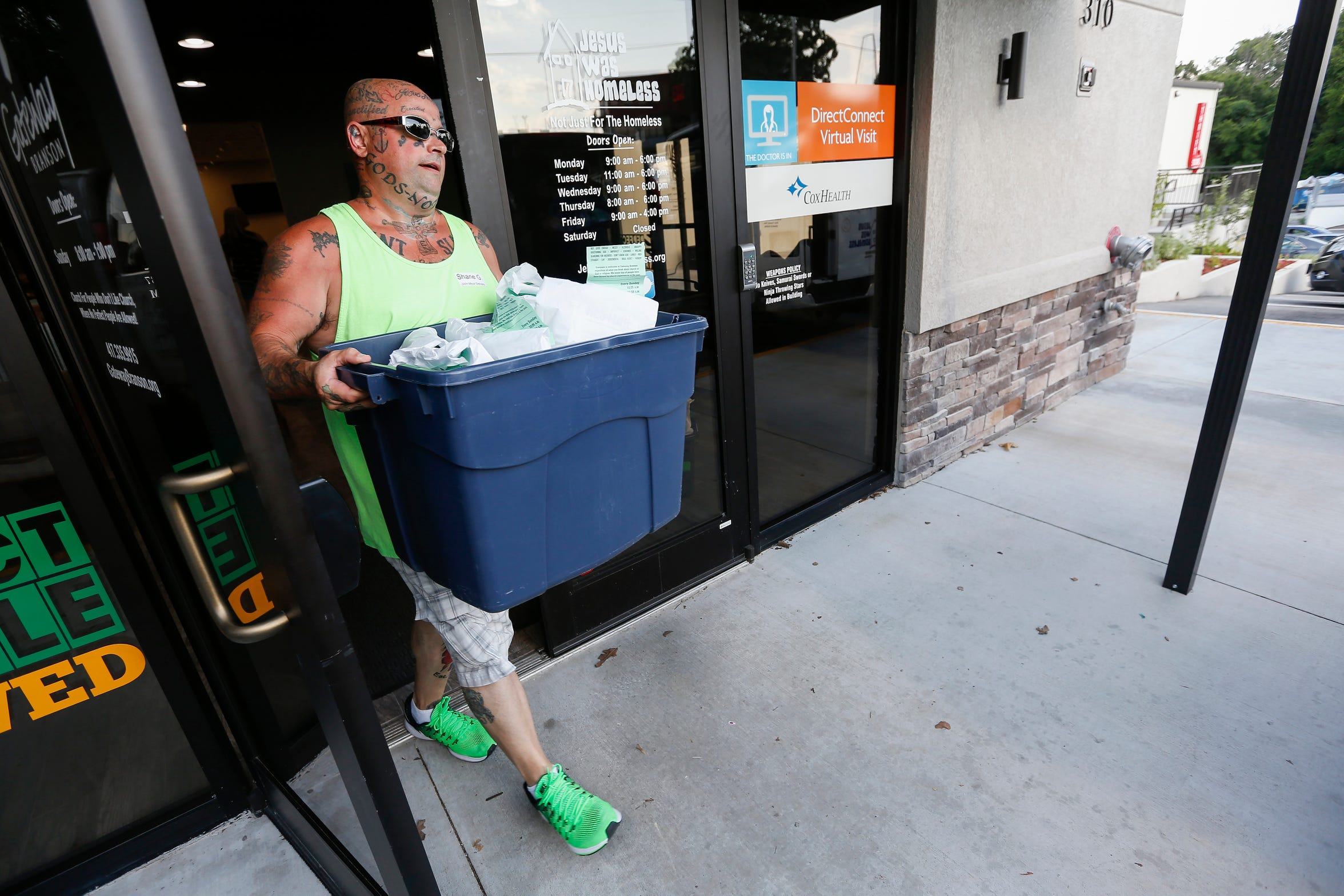 Shane Gehlert, of Branson, loads meals into vans at Jesus Was Homeless in Branson on Thursday, July 5, 2018. Volunteers were bringing meals to people living in extended stay hotels.