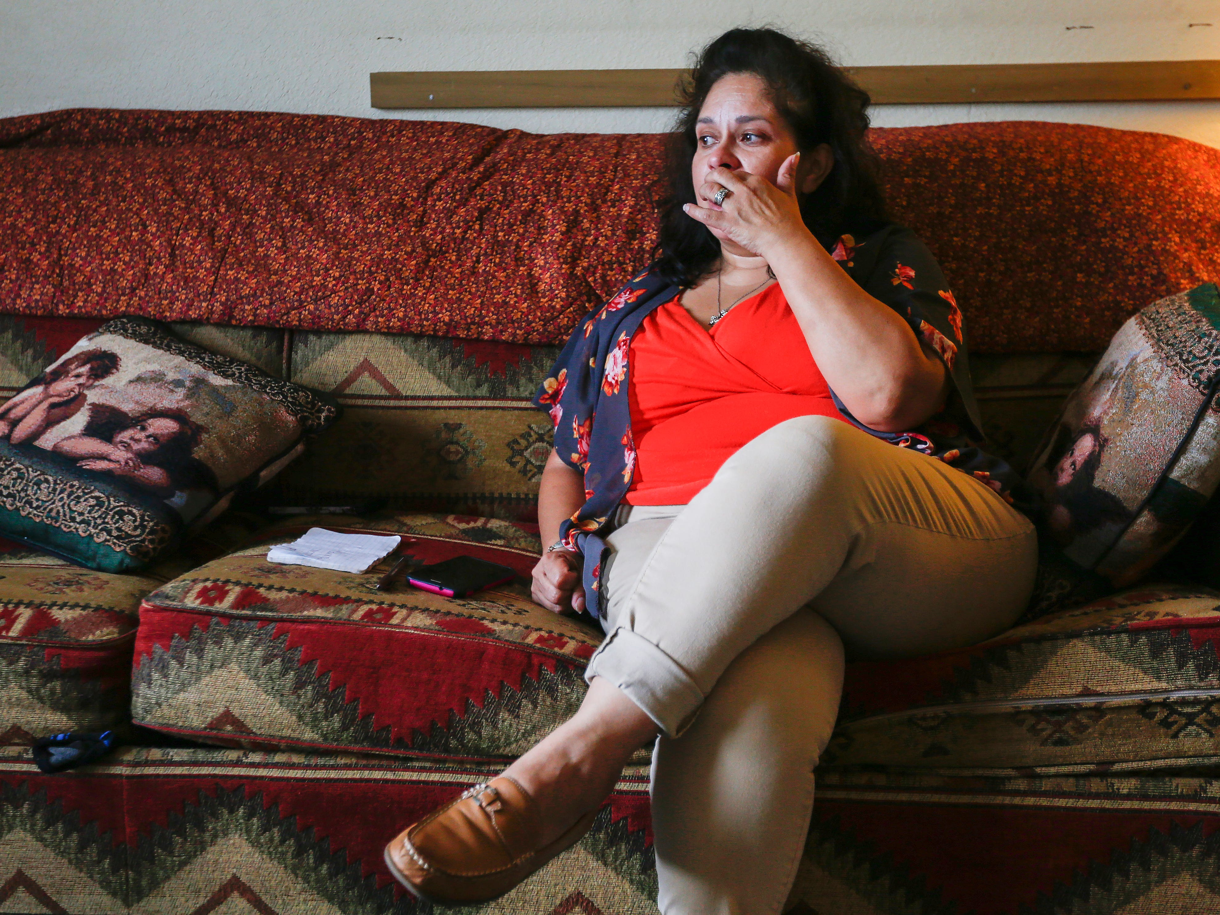 Chrystal Ketterman gets choked up while talking about the death of her father inside of her room at the extended stay hotel she is living in in Branson on Monday, July 30, 2018.