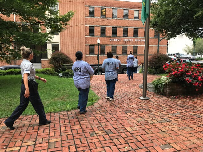 Female inmates from Middle River Regional Jail carry deed records Tuesday from the Augusta County Courthouse in an effort to protect them from potential flooding.