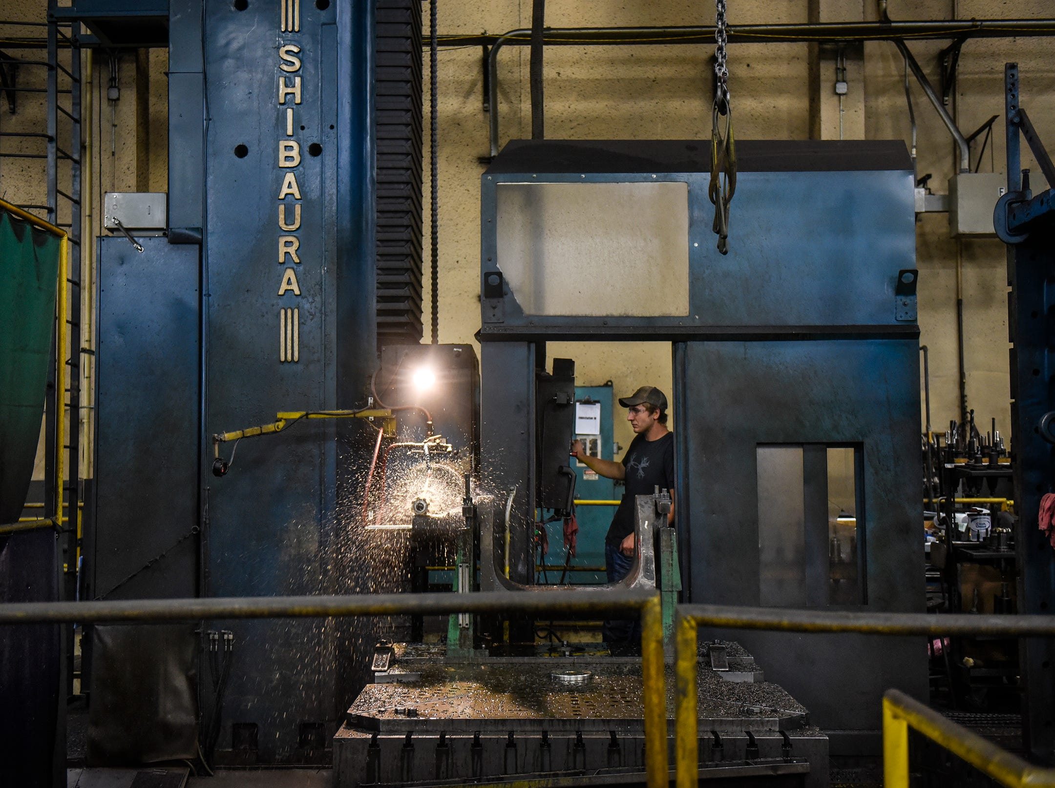 A milling machine does its job Monday, Sept. 10, at the DeZURIK plant in Sartell.
