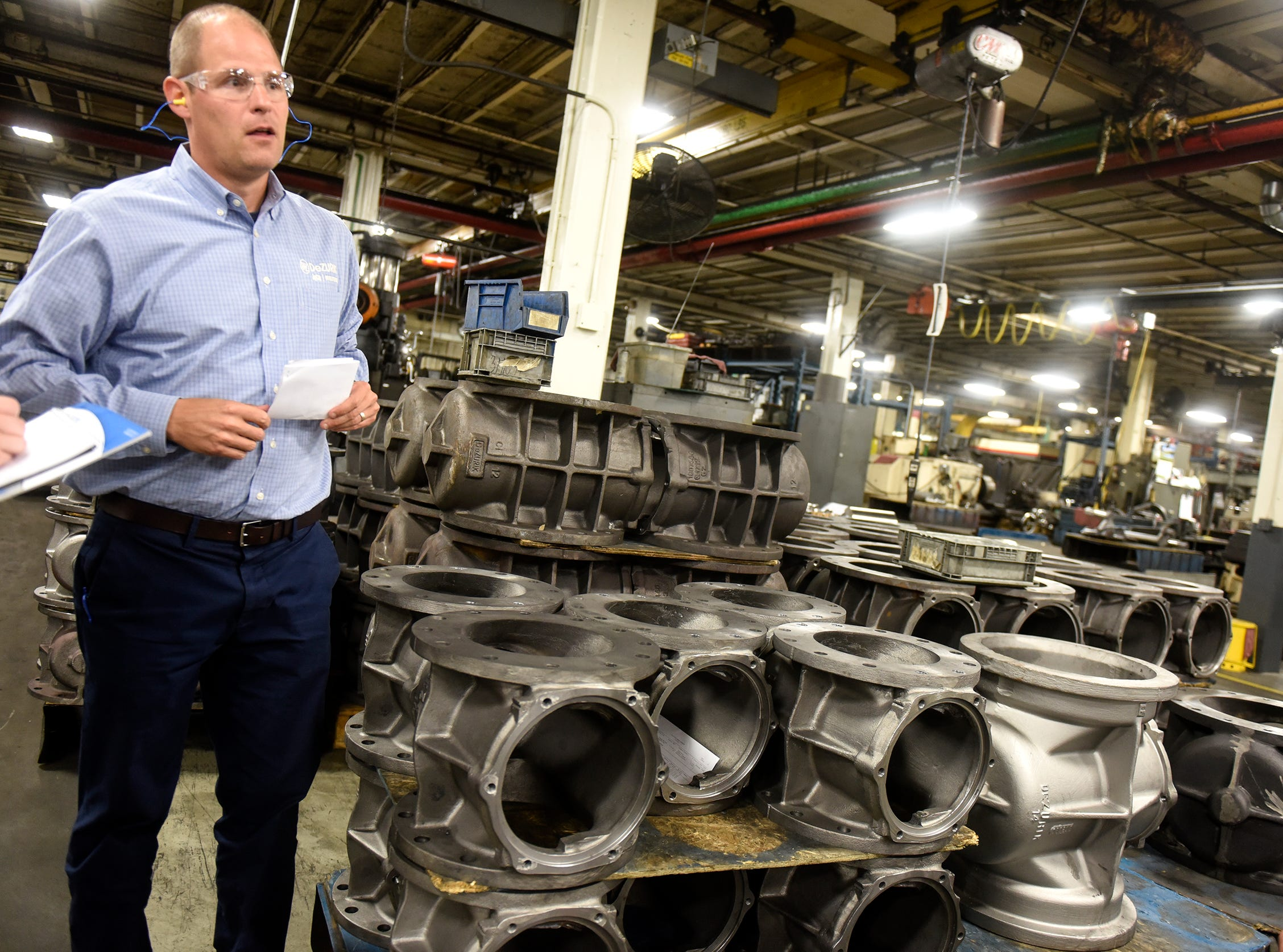 CEO and President Bryan Burns talks about the processes used in manufacturing valves Monday, Sept. 10, at the DeZURIK plant in Sartell.