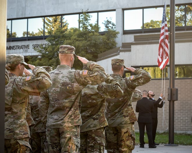 ROTC members salute during a Patriot Day Flag Raising ceremony Tuesday, Sept. 11, in front of the administrative services building at St. Cloud State University.