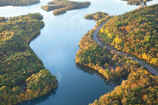 A curving road along the Mississippi River near Brainerd in the fall.