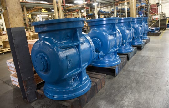 Large valves are painted in the signature blue Monday, Sept. 10, at the DeZURIK plant in Sartell.