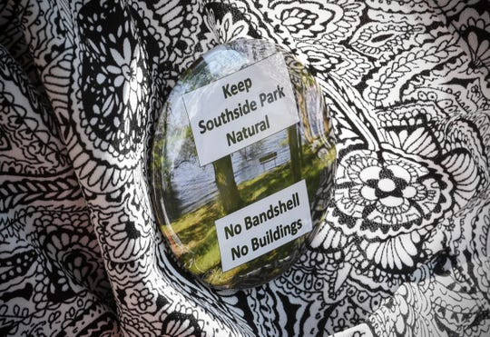 Brenda Graves wears a button showing her views on proposed developments Monday, Sept. 10, at Southside Park in Sauk Rapids.