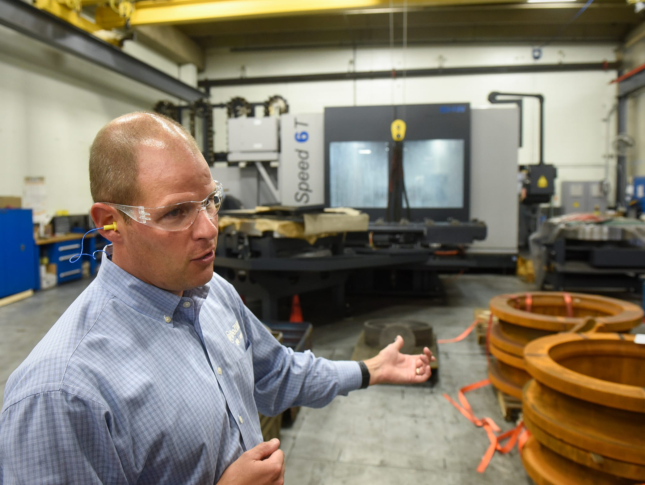 CEO and President Bryan Burns talks about a recently installed piece of milling equipment used in the manufacture of large valves Monday, Sept. 10, at the DeZURIK plant in Sartell. The facility will be holding an open house in celebration of the 90th anniversary Saturday, Sept. 22.
