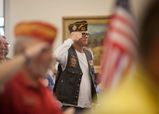 Veterans salute the flag during Patriot Day services at the Southern Utah Veterans Home in Ivins on Sept. 11, 2018.
