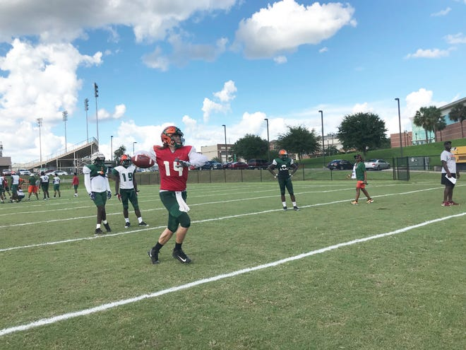 Quarterback Ryan Stanley rolls to his left to fire off a pass in practice.