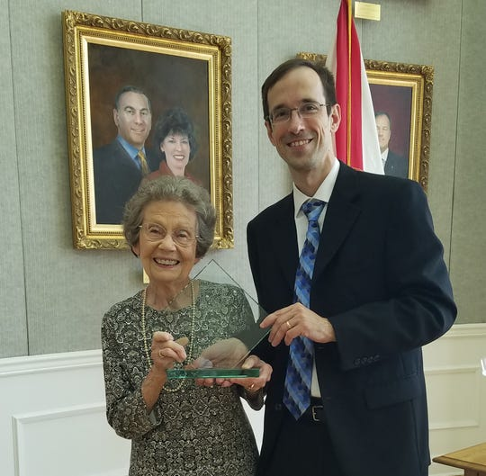 "Attorney Kevin Cox presents Dorothy ""Dot"" Binger with the Glenn J. Winuk Humanitarian Service Award Tuesday, Sept. 11, for her volunteer efforts as a guardian ad litem."