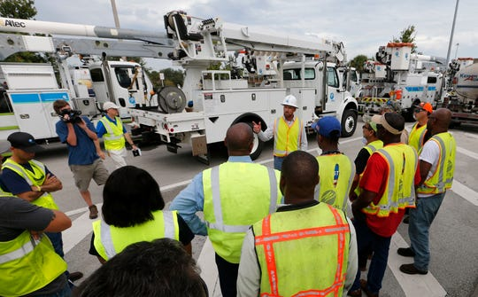 Wade Jollimore, center, Broward County distribution operations leader for FPL, discusses safety procedures with FPL employees and contractors before they leave for South Carolina from the West Palm Beach Service Plaza on Florida's Turnpike in Lake Worth Tuesday.