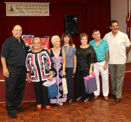 Spanish American Club members and door prize winners, from left, Ruben Aleman, Evelyn Carrillo, Elizabeth Mejia, Nancy Rozon, Maria McCuthcheon, Carlos Mejia and Ray Guadalupe.