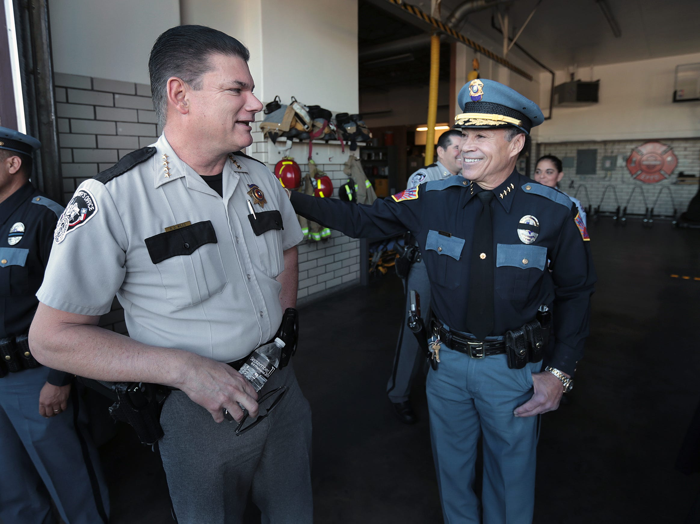 El Paso County Sheriff Richard Wiles, left, talks with El Paso Police Chief Greg Allen during the 9/11 Memorial Ceremony Tuesday at Fire Station 18.