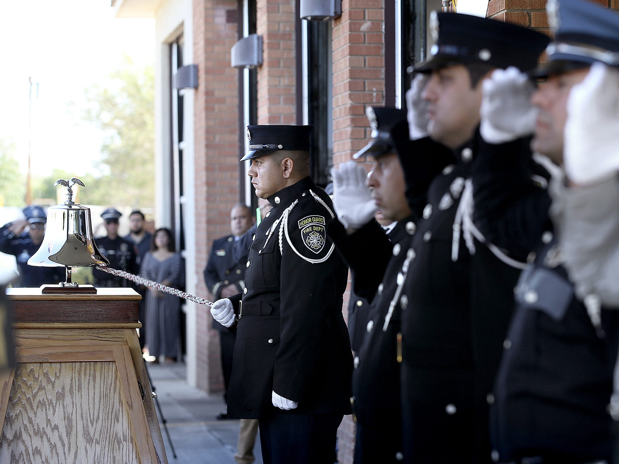 A member of the El Paso Fire Department Honor Guard rings the Final Alarm to honor  the 343 New York City Firefighters, 23 NYPD officers and 37 Port Authority Officers who lost their lives on 9/11. They also honored the soldiers who have lost their lives fighting terrorism since 9/11. A memorial ceremony was held Tuesday at Fire Station 18.