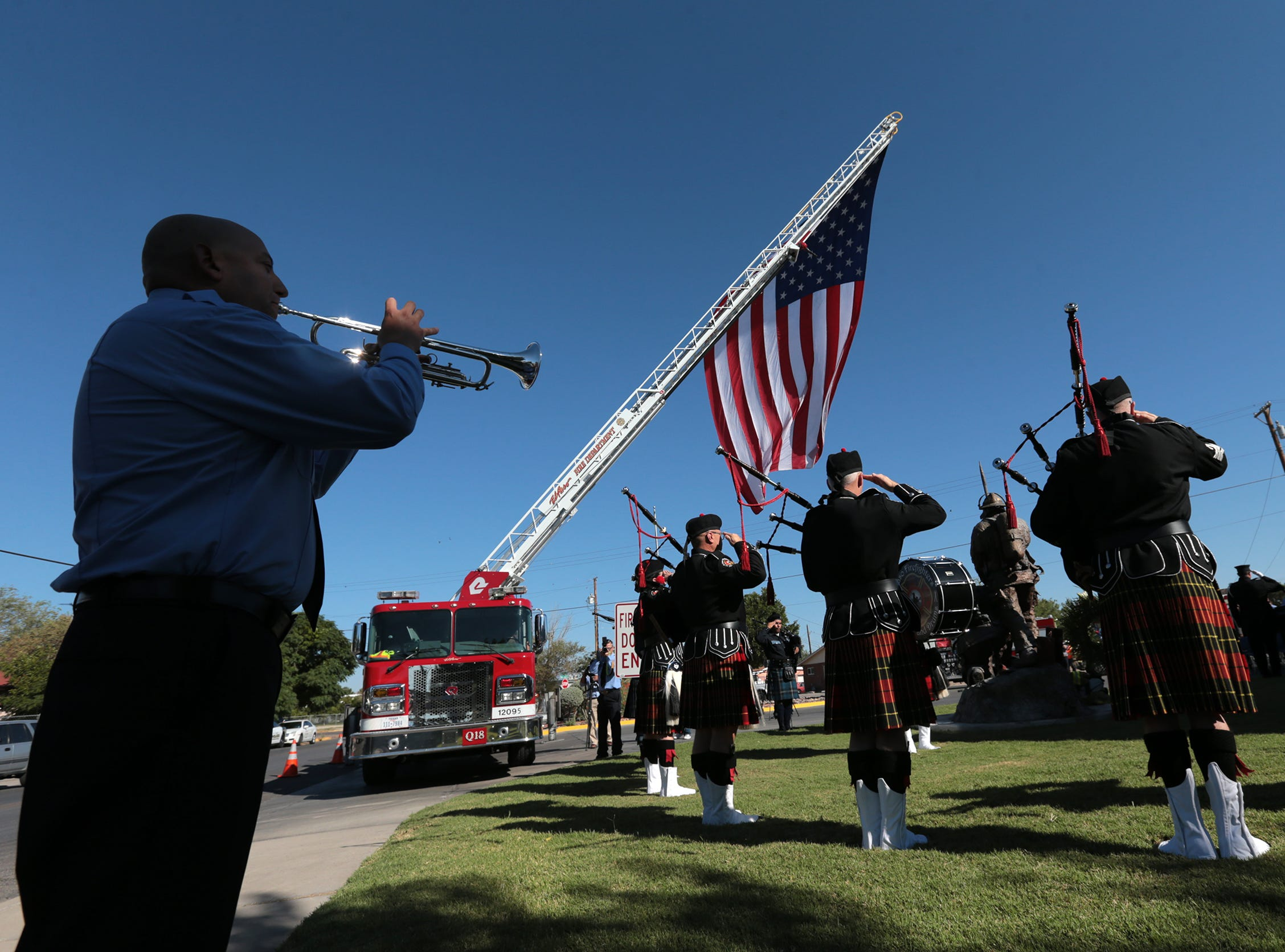 A firefighter plays taps during the 9/11 Memorial Ceremony Tuesday at Fire Station 18.