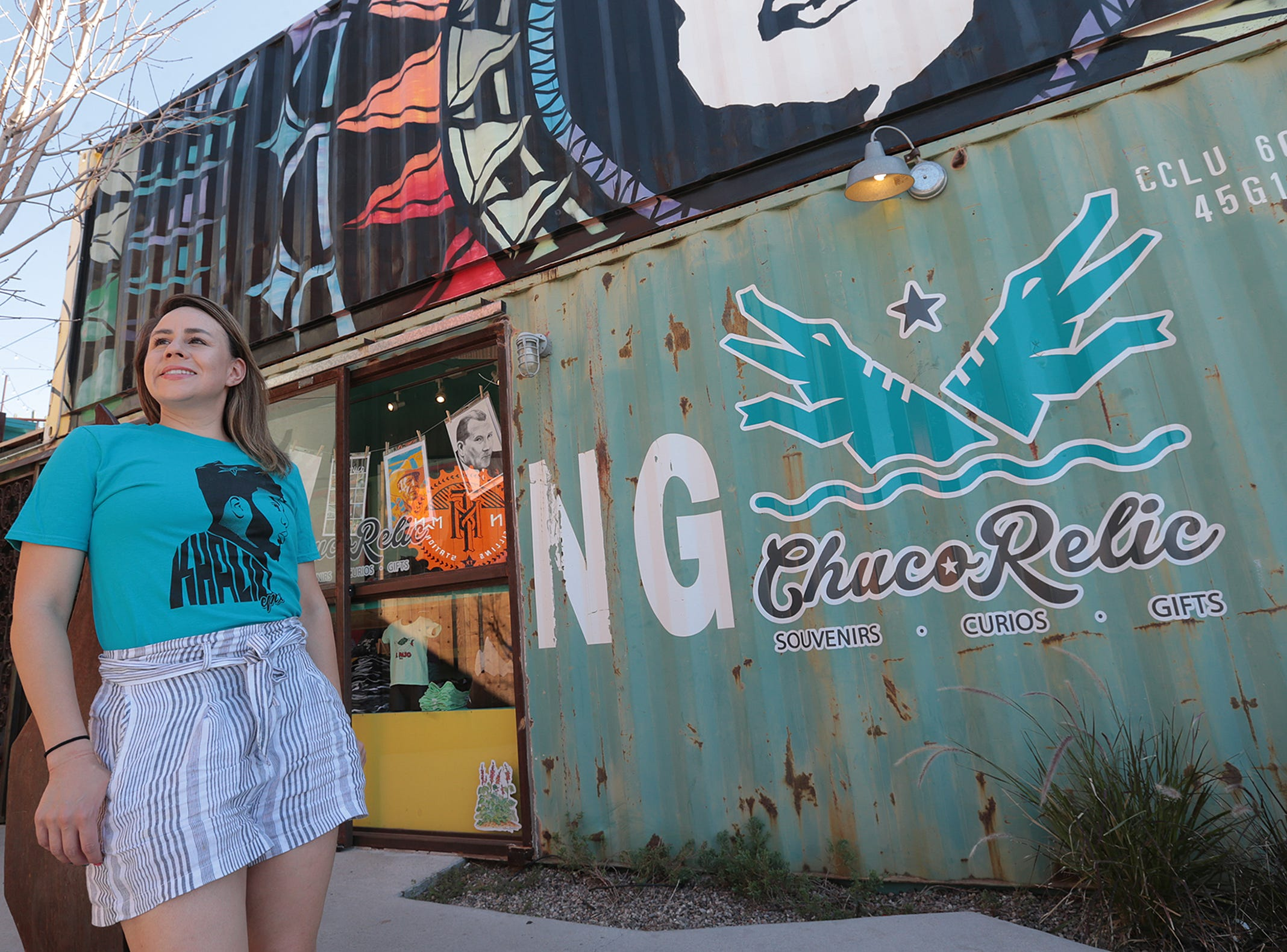 Chuco Relic owner Chelsie Evaldi models one of her Khalid t-shirts outside her shop at Time at Montecillo.