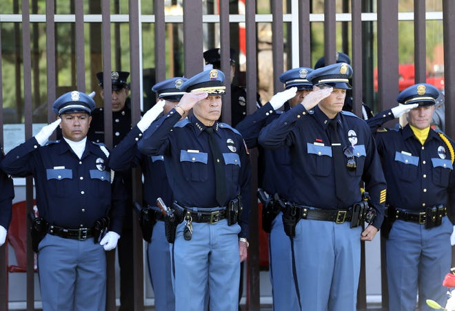 El Paso police Chief Greg Allen joins officers at the 9/11 memorial Tuesday at Fire Station 18.