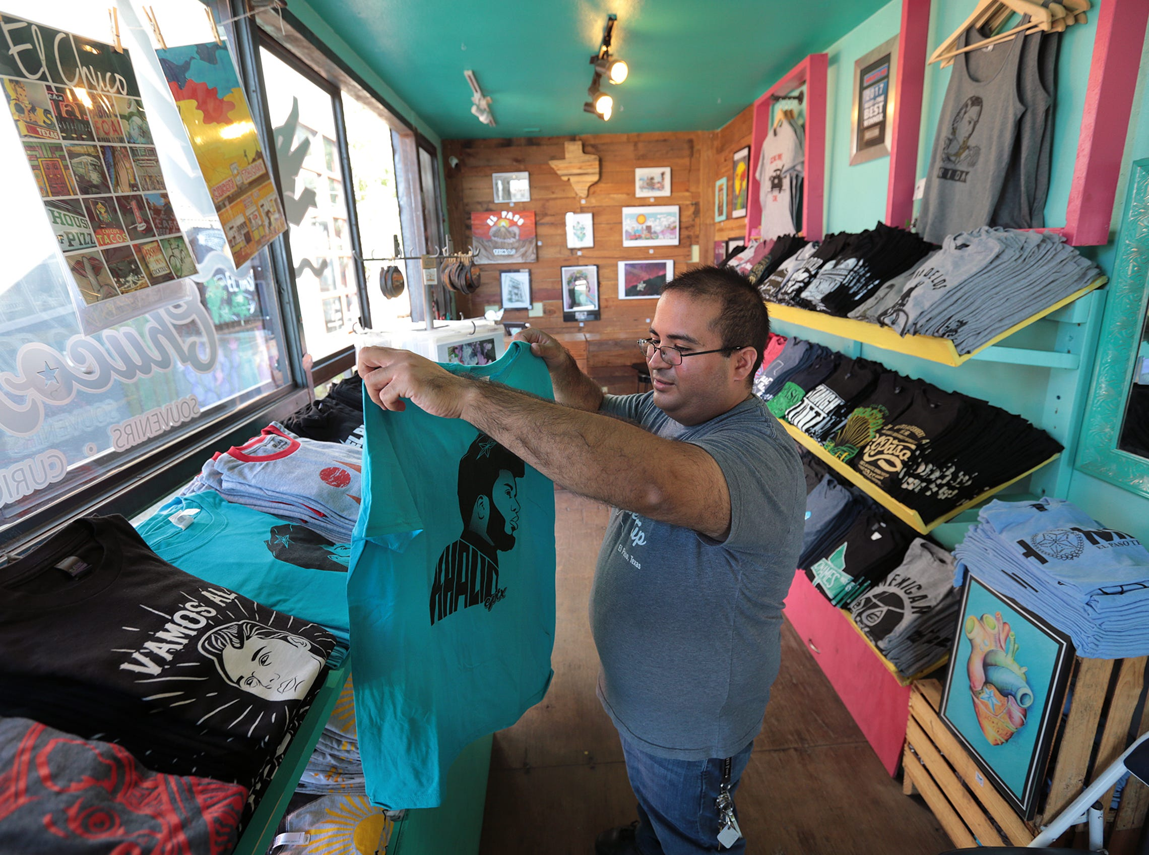 Chuco Relic manager Andrew Candelaria shows the Khalid t-shirt sold at the store at Time at Montecillo. The shirts have been selling well with the upcoming concert.
