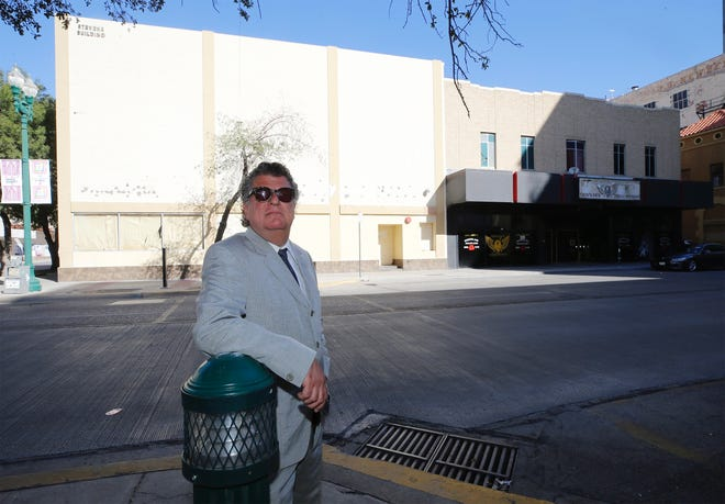 """El Paso businessman William """"Billy"""" Abraham stands in front of two of his Downtown buildings tied up in bankruptcy court. The Lion's Den, right, at 209 Texas Ave., was sold for $335,000 Tuesday during a court hearing."""