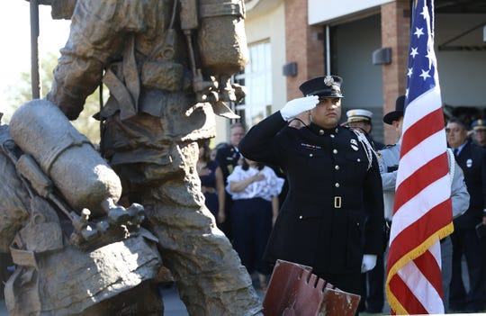 A firefighter played taps during the 9/11 Memorial Ceremony last year at Fire Station 18.