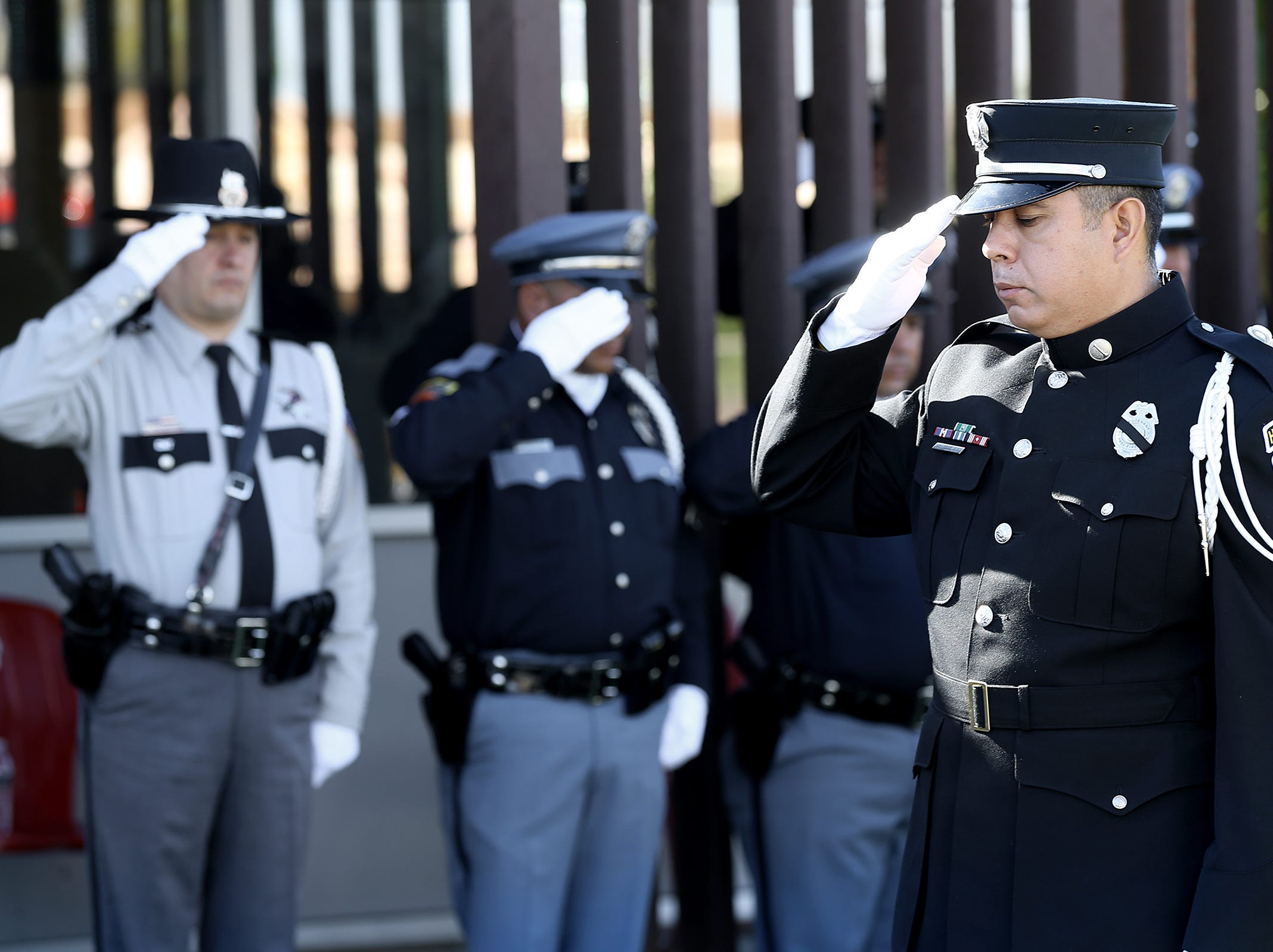 A member of the El Paso Fire Department Honor Guard salutes the 9/11 memorial at Fire Station 18 during the 9/11 Memorial Ceremony Tuesday.