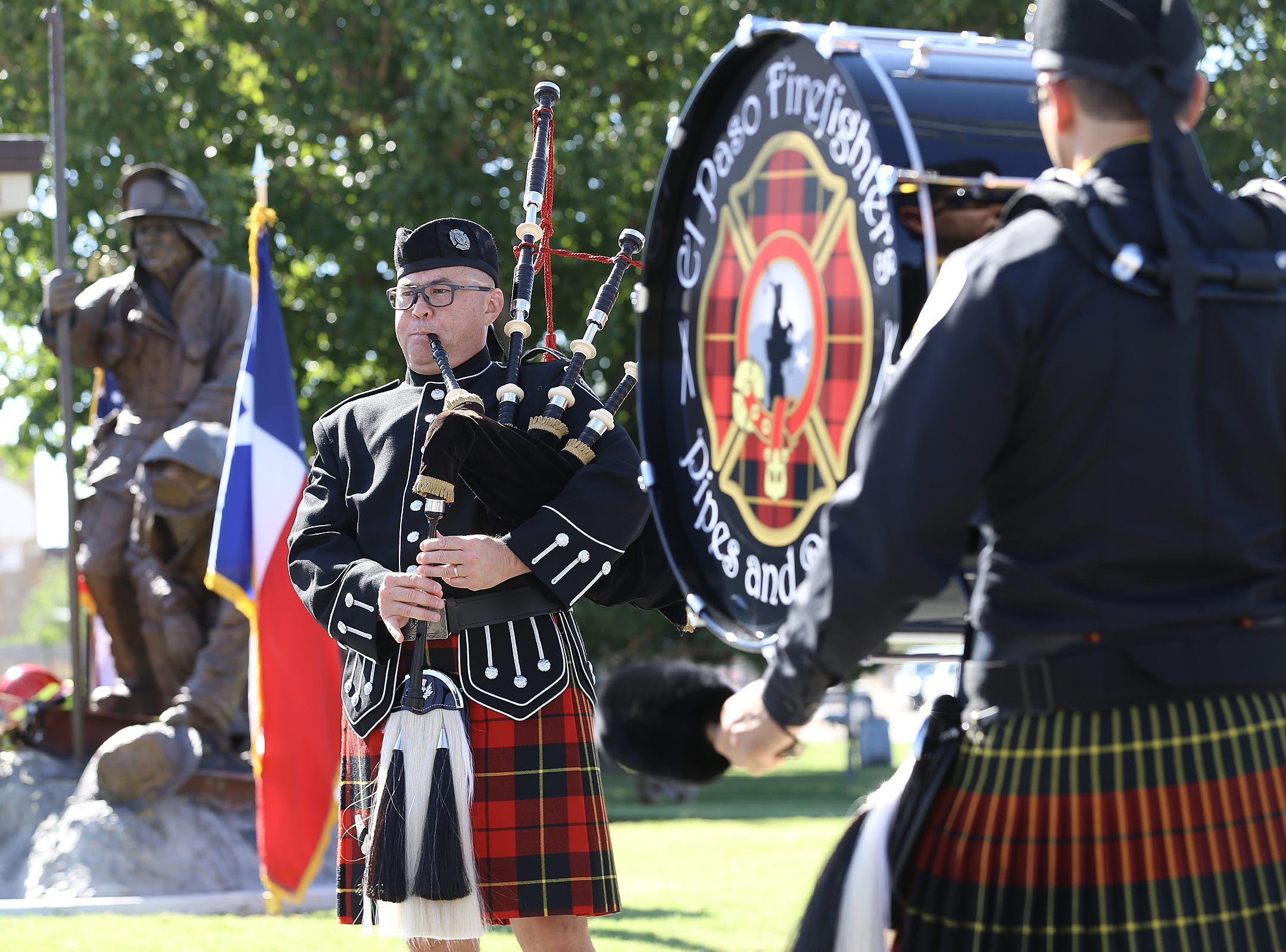 The El Paso Fire Department Pipes and Drums and El Paso Police Department pipes play at the site of the 9/11 memorial at Station 18.