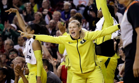 Buena High graduate Sami Whitcomb celebrates a basket by the Seattle Storm during a playoff game. Whitcomb and the Storm are on the cusp of an WNBA title.