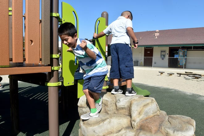Aiden Santos, a kindergartener at Conejo Elementary School in Thousand Oaks, climbs down from the school's new handicapped-accessible playground equipment on Tuesday.