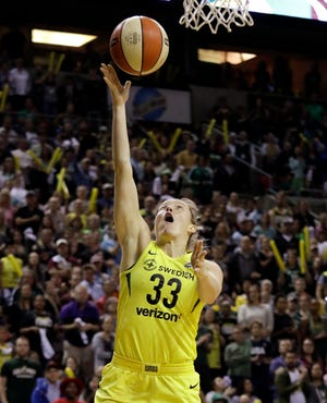 Buena High graduate Sami Whitcomb sails in for a layup during the Storm's win over the Mystics in Game 2 of the WNBA Finals on Sunday in Seattle.