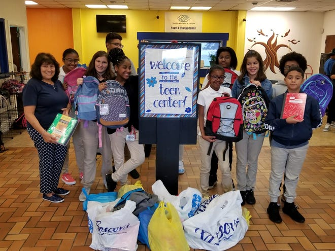 Linda Gallina (left) from the Woman's Club of Vineland delivered donations from members of her club to the kids at the Boys & Girls Club of Vineland.