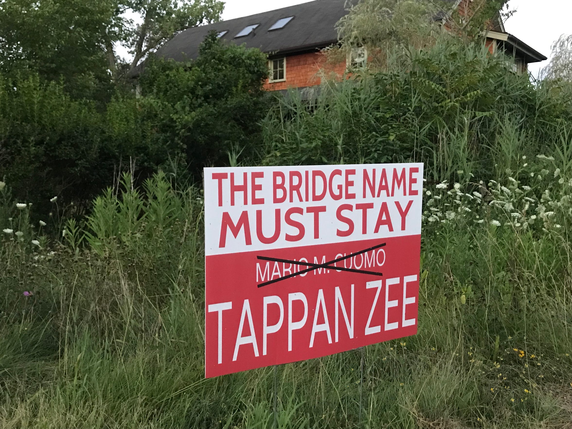 A sign protesting name change of the new bridge in Piermont.