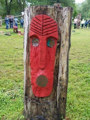A carving on one of the posts ringing the  prayer circle at the Ramapough Lenape Spit Rock Sweet Water Prayer Camp on Sept. 9, 2018.