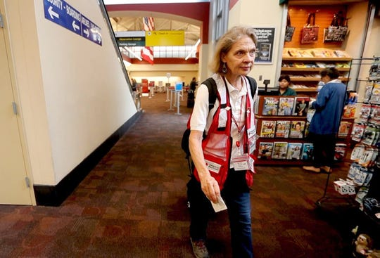 Red Cross volunteer Elizabeth Anderson of Yorktown Heights walks through the terminal at the Westchester County Airport Sept. 11, 2018. Anderson is heading to Myrtle Beach, S.C. to assist in disaster relief for Hurricane Florence, which is expected to make landfall in the Carolinas beginning Wednesday.