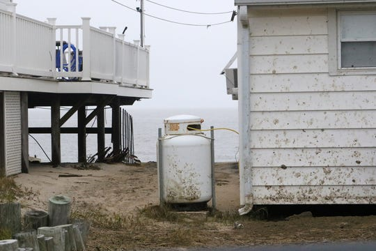 During hurricanes and nor'easters that hit Bowers Beach, it is not uncommon to see 100-gallon propane tanks that have broken away from houses floating in flood waters.
